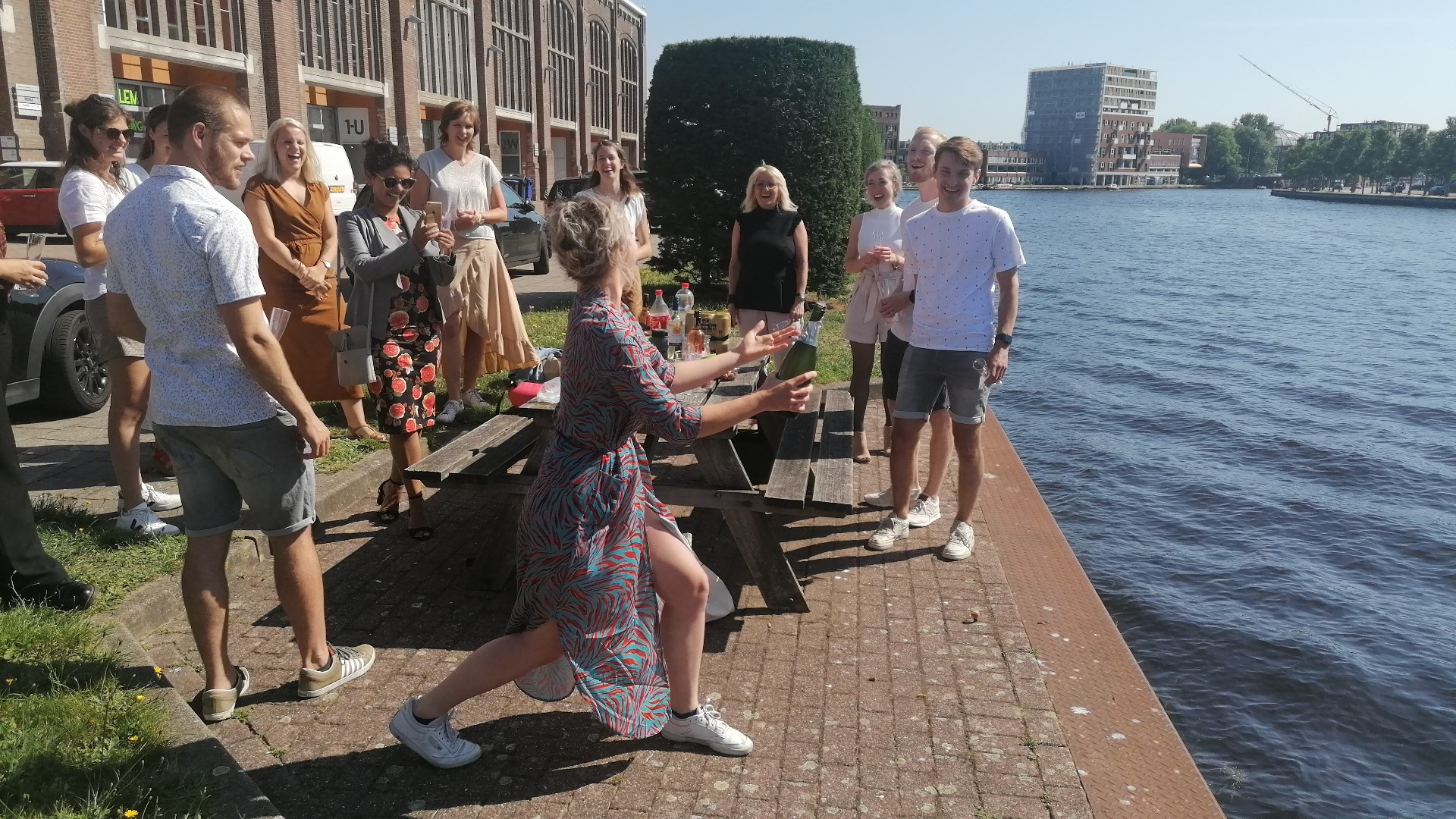 lyla popping champagne next to the canal in haarlem