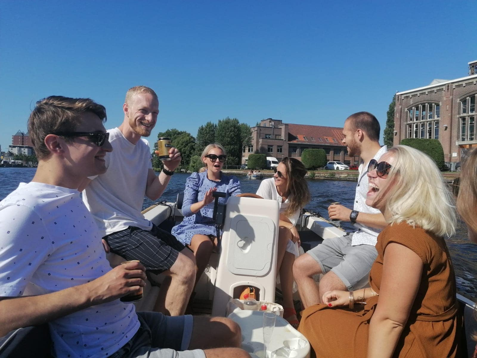 group of collegues lauging on a boat on the canal in Haarlem